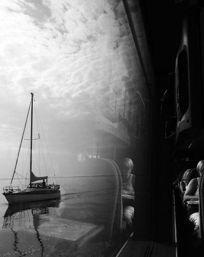 Time To Reflect Blackandwhite Mission Mystery EyeEm Best Shots window reflection of a ferry boat