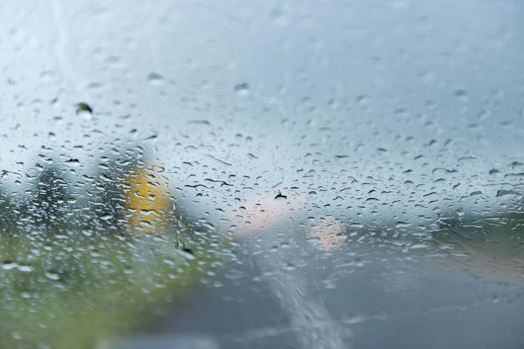 Rain drops on car windshield.