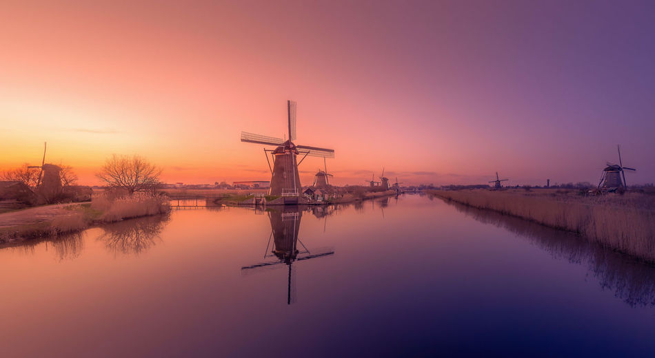 Remo SCarfo Windmills Water Reflection Sky Sunset Nature Beauty In Nature Scenics - Nature No People Tranquility Fuel And Power Generation Environment Lake Tranquil Scene Standing Water Waterfront Orange Color Wind Power Wind Turbine Kinderdijk Holland Dutch