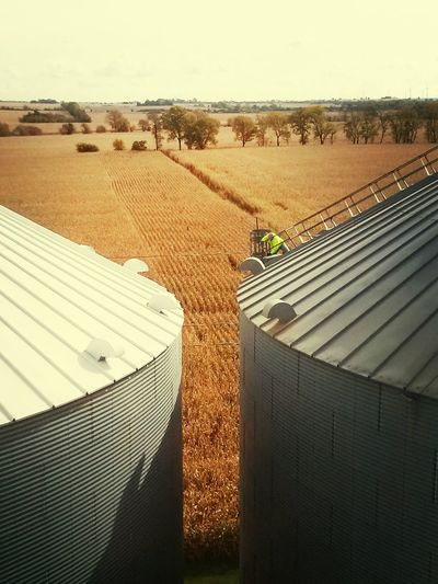 It's Business Time My buddy checking the corn level in the grain bin