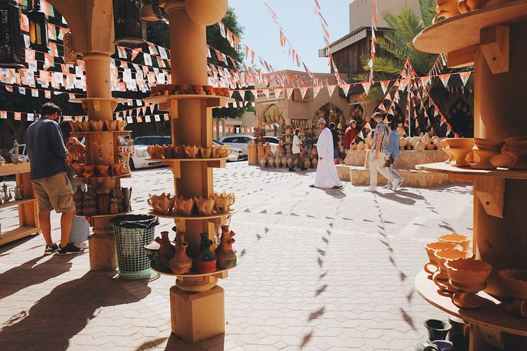Nizwa Nizwa Fort Nizwa Souq Market Outdoors Large Group Of People Vacations Travel Tourism Tourist Attraction  People Visitors Marketplace Traditional Culture Handicraft Pottery Handmade Exploring Shop Shopping ♡ Oman Oman_photography