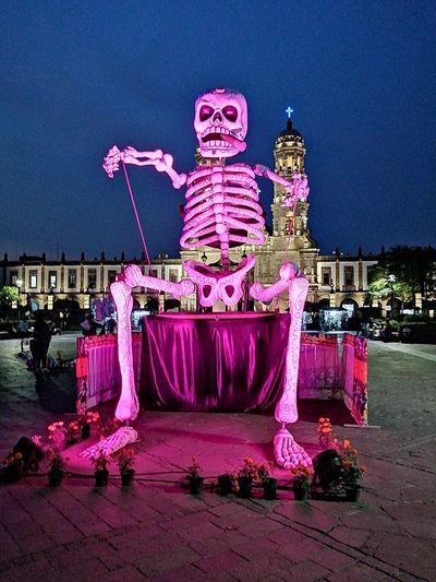 Illuminated sculpture in amusement park at night