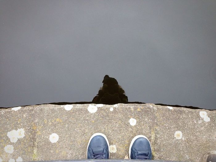 High angle view of shoes against lake