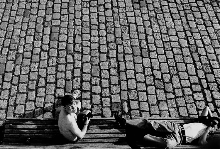 High angle view of woman photographing outdoors
