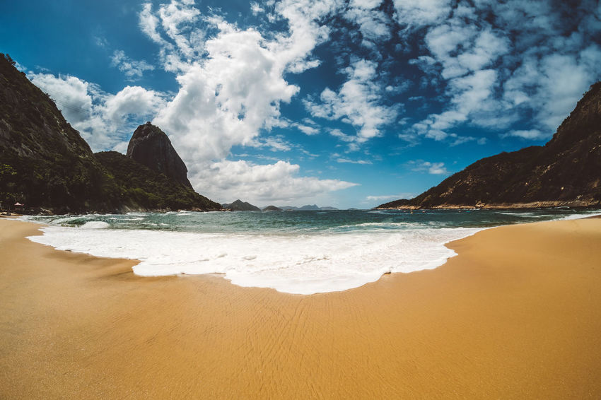 the beach. Beach Sea Water Sand Sky Shore Coastline X-PRO2 Mountain Cloud Beauty In Nature Non-urban Scene Nature Travel Destinations Rio De Janeiro