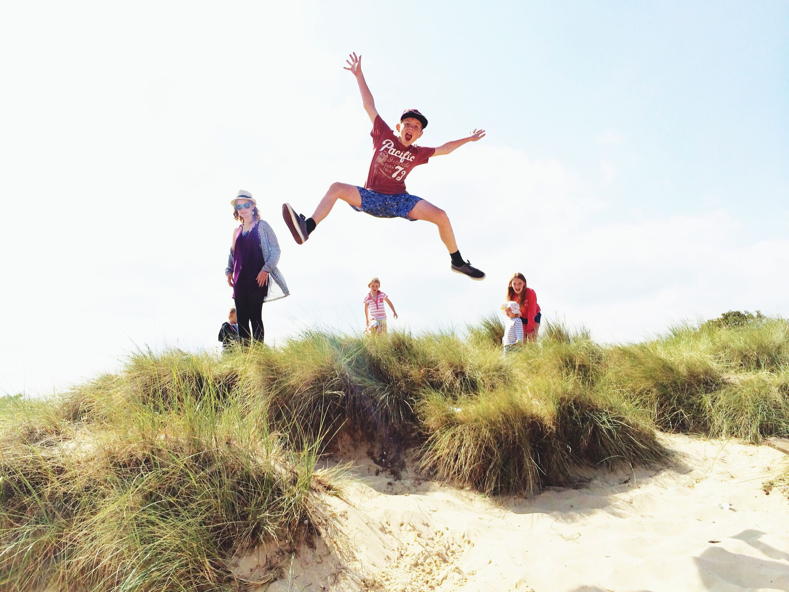 leisure activity, lifestyles, full length, fun, enjoyment, jumping, mid-air, togetherness, happiness, bonding, casual clothing, person, childhood, carefree, boys, playing, freedom, playful, arms outstretched