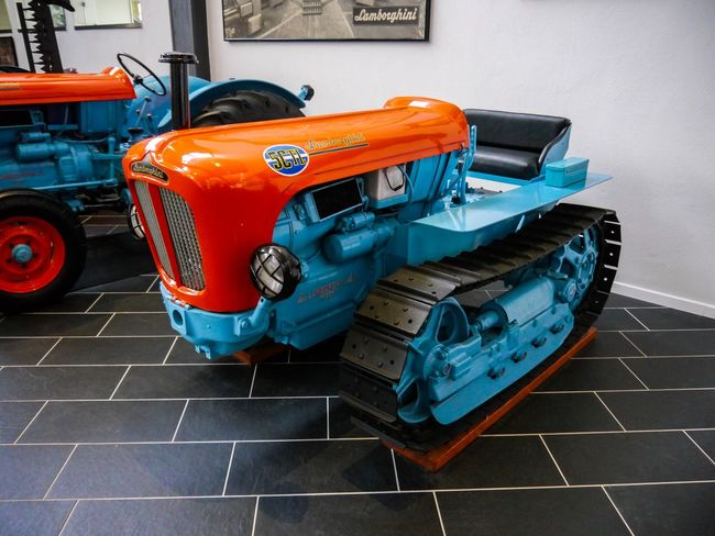 Bulldozer Little Tractor Red Tractor Lamborghini Tractor Red Tractor Mode Of Transportation No People Transportation Orange Color Car Art And Craft Toy Car Land Vehicle Flooring Travel Street Representation Motor Vehicle Day Toy City Creativity High Angle View Tile Multi Colored