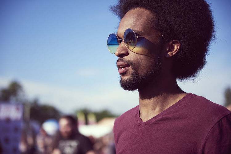 Shot of young African man with sunglasses Man African African American Festival Music Festival Party Music Outdoors Entertainment Summer Sunglasses Fashion Fashionable Copy Space Youth Culture Carefree Freedom Adult Young Adult Traditional Festival Vacations Traveling Carnival Live Event Popular Music Concert Black Afro Close Up Sunlight Sunny STAND Side View Beard Hairstyle