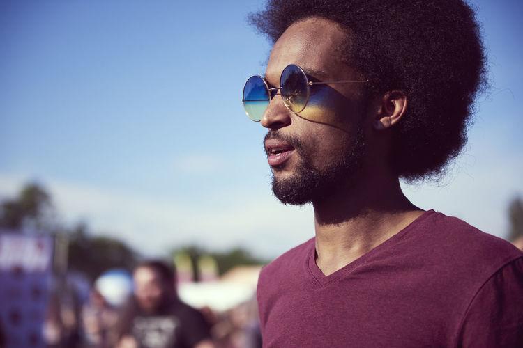 Man wearing sunglasses against sky