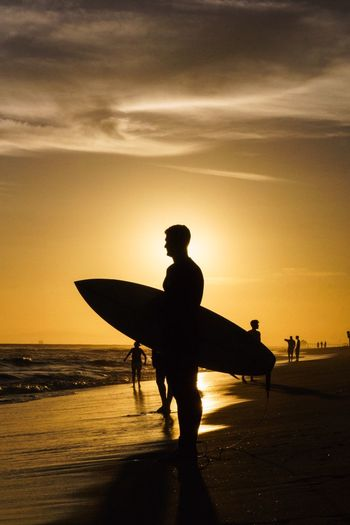 Golden Surf Sunset Sillouette