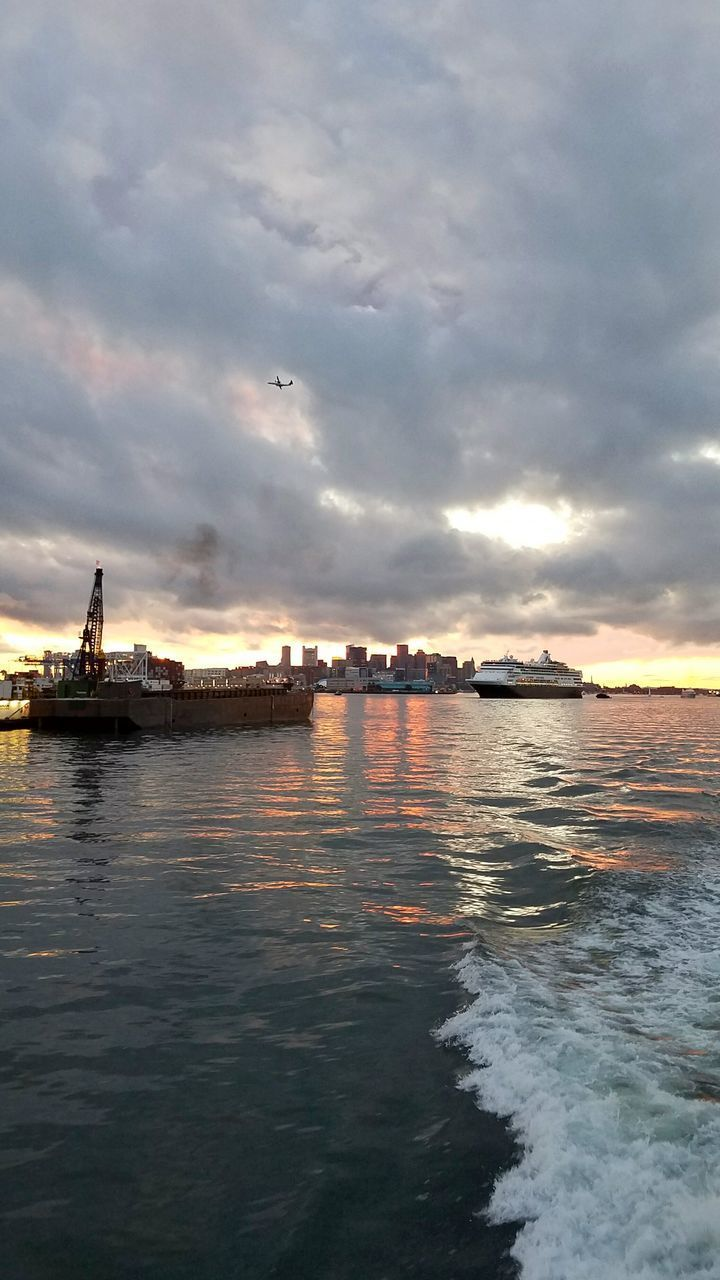 water, cloud - sky, sky, sea, waterfront, nautical vessel, transportation, sunset, nature, no people, beauty in nature, mode of transportation, scenics - nature, architecture, outdoors, ship, dusk, tranquility
