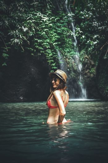 Girl in sunglasses and straw hat on a background of a waterfall. Bali island. Bali, Indonesia Bali Tourist Adventure Tourism Exploring Traveling Waterfall Trip Water One Person Real People Clothing Women Young Women Nature Tree Splashing Plant Young Adult Leisure Activity Lifestyles Females Beauty Waterfront Beauty In Nature Adult Outdoors Beautiful Woman