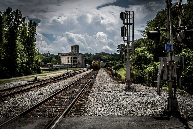 Rolling Down the Tracks Blackandwhite Blue Building C Composition Direction Engine Gravel Guidance Leading Narrow Perspective Railroad Railroad Tracks Sky The Way Forward Train, White