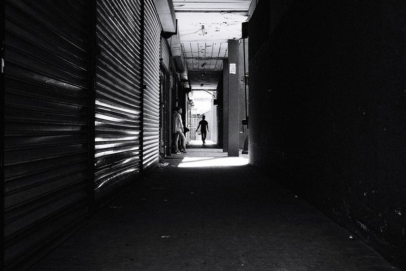 Into the Light - I just love exploring my own back yard but unfortunately due to the recent spike in crime,one has to be careful. Eldoradopark Johannesburg South Africa Black And White Bnw Backyard Urban Exploration The Street Photographer - 2018 EyeEm Awards Full Length Corridor Architecture Built Structure Passage Entrance Passageway