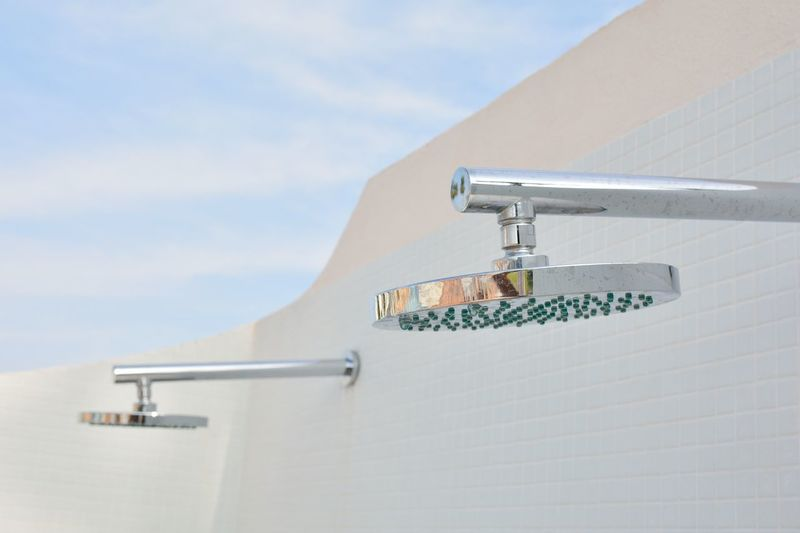 Close-up of faucet against blue sky