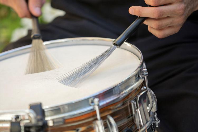 Close-up of man playing drum
