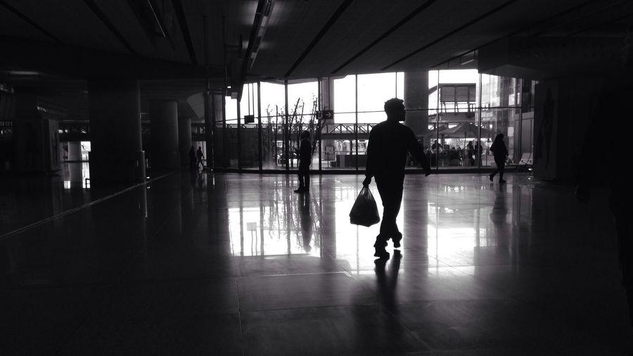 Silhouette of woman in corridor