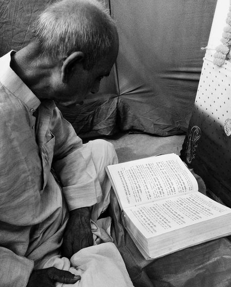 "My Grandfather reading the Holy scripture ""Ramayana"". One Person Indoors  Adult Hello World Black And White Blackandwhite EyeEm Best Shots Check This Out Vscocam VSCO Text Paper Close-up Taking Photos Eye4photography  Monochrome Book Reading Sunlight Light And Shadow Old Sitting Silhouette Uniqueness The Portraitist - 2017 EyeEm Awards"