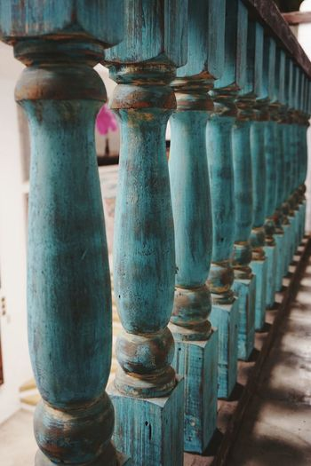 Row Of Blue Wooden Balustrade