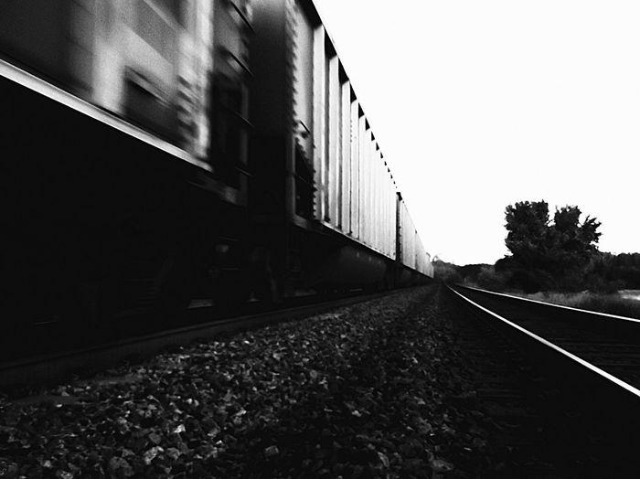 Train In Motion Blackandwhite Train Track Black And White Train Trainers K Train Close-up Close Up Photography Black-and-white Outdoor Photography Sky Railroad Track Railroad Tie Freight Train Railroad Car Rail Transportation