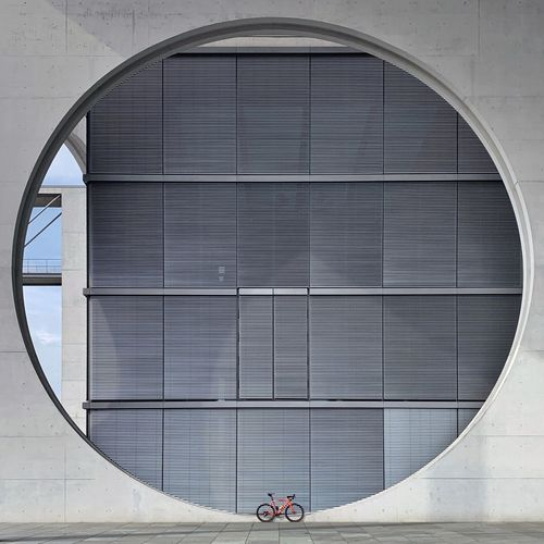 Bicycle parked against built structure