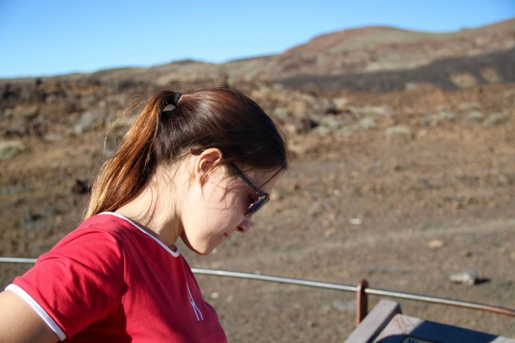 Close-up of woman in sunglasses against mountain at el teide national park on sunny day