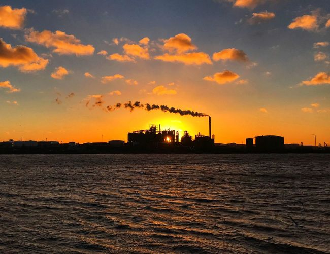 Sky Cloud - Sky Sunset Water Architecture Orange Color Built Structure Factory Smoke - Physical Structure Waterfront Industry Pollution Smoke Stack Silhouette