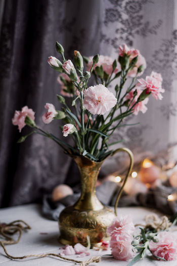 Close-up of pink flowers vase on table