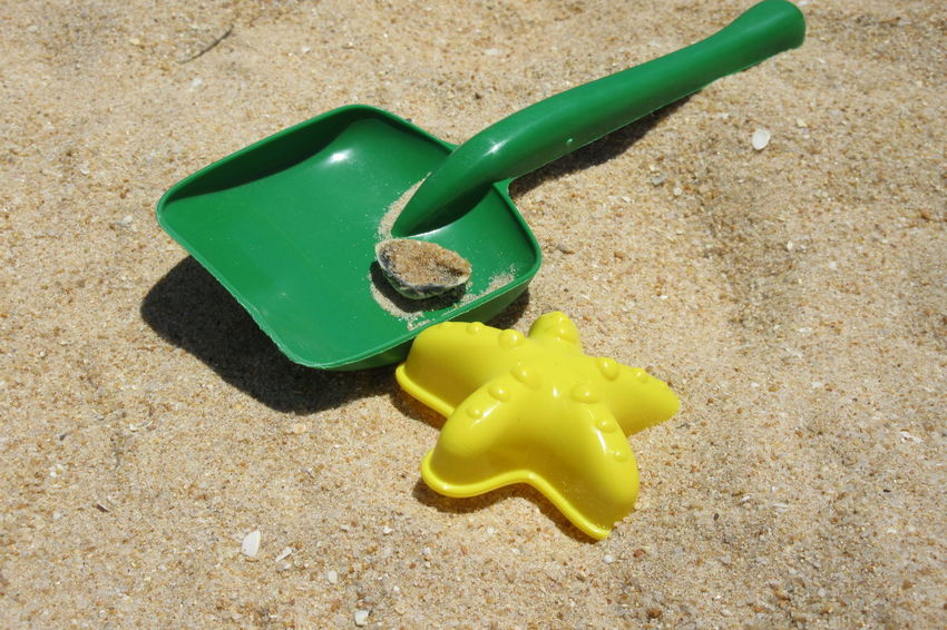 'Seaside tools' Beach Life By The Sea Beach Close-up Day Green Color Green Spade No People Outdoors Sand Sand Play Sand Toys Shell Summer Time  Yellow Yellow Star