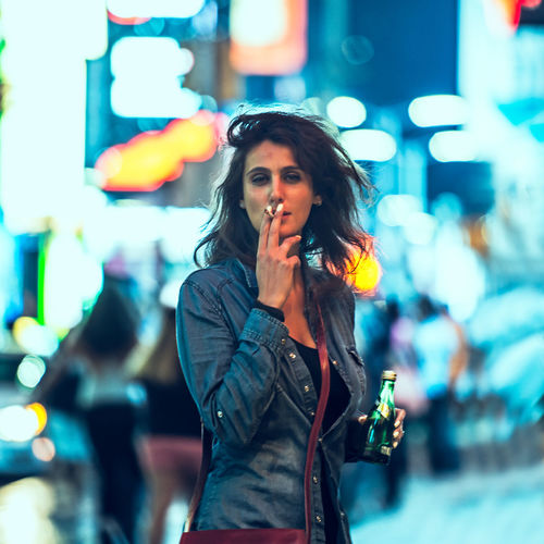 Cigarrette & Water NYC Street NYC Beautiful Woman Beauty Casual Clothing City City Life City Street Crowd Enjoyment Focus On Foreground Happiness Illuminated Incidental People Leisure Activity Lifestyles Neon Night One Person Outdoors Real People Smiling Standing Street Warm Clothing Young Adult Young Women Stories From The City The Portraitist - 2018 EyeEm Awards The Art Of Street Photography My Best Photo