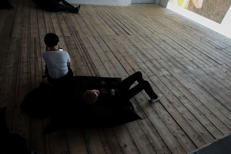 High angle view of boy on floor