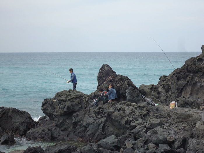 Beach Day Fisherman Fishermen Horizon Over Water Nature Outdoors People Real People Rock - Object Sea Sky Water