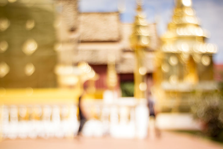 abstract defocused background of golden temple, blur background with beautiful bokeh Beautiful Bokeh Chiangmai Gold Golden Temple Pagoda Reflection Thailand Tourist Wat Phra Singh Wat Phra Singh Woramahawihan Abstract Architecture Belief Blur Blur Background Bokeh Building Defocused Destination Luxury Nature Outdoors Religion Temple Travel Destinations