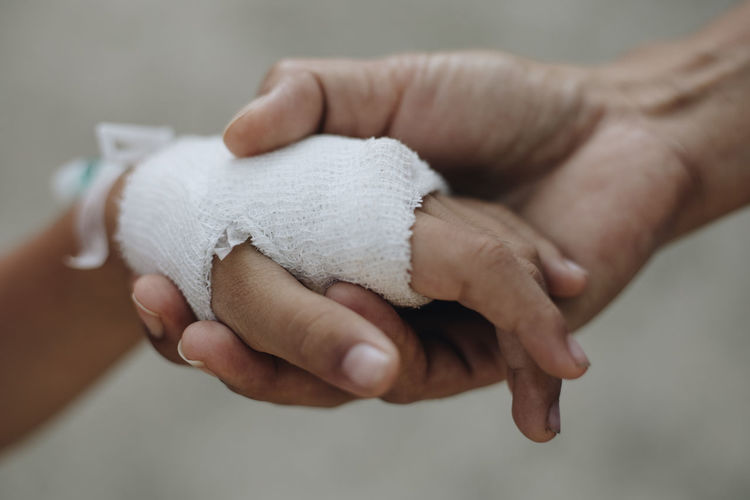 Close-up of hand with bandage