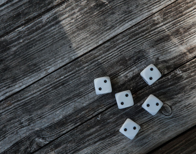 10 5 Spotted Arts Culture And Entertainment Cube Shape Dice Directly Above Gambling Group Of Objects High Angle View Leisure Activity Luck Number Opportunity Pattern Still Life Table Ten Textured  Wood - Material