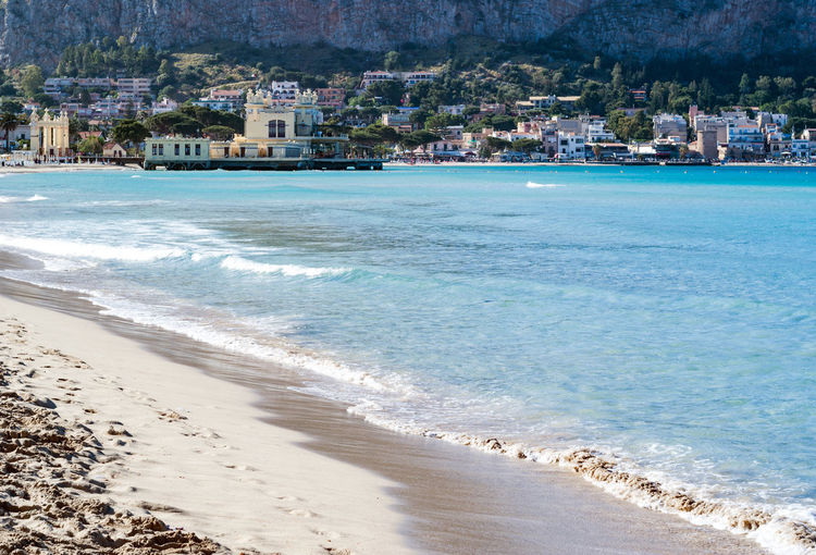 The famous beach of Mondello in Palermo, Sicily Beach Photography Palermo Palermo, Italy Palermo❤️ Architecture Beach Beachphotography Beauty In Nature Building Exterior Built Structure City Day Land Mondello Mondellobeach Mondello❤ Motion Nature Outdoors Palermo Shooting Sand Scenics - Nature Sea Water Wave