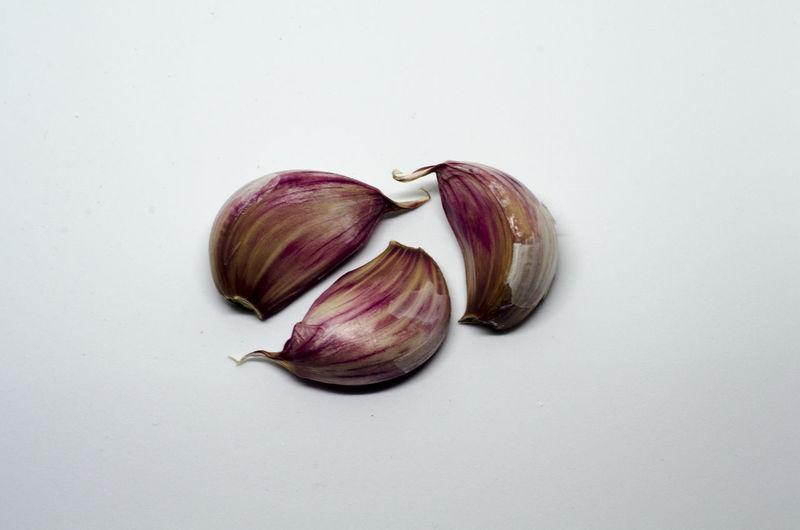 Three cloves of garlic Ajo Close-up Food Food And Drink Freshness Garlic Garlic Bulb Garlic Clove Healthy Eating No People Studio Shot White Background
