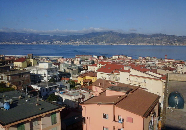 Straitofmessina Strait Of Messina Villa San Giovanni Architecture Building Building Exterior Built Structure City Cityscape Crowded Day High Angle View Mountain Nature Outdoors Residential District Roof Sea Sky Stretto Di Messina Strettodimessina TOWNSCAPE Villasangiovanni Water