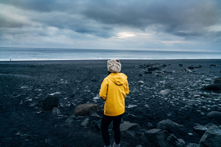 Beach Beauty In Nature Casual Clothing Cloud - Sky Full Length Getting Away From It All Horizon Over Water Iceland Leisure Activity Lifestyles Nature Non-urban Scene Scenics Sea Shore Sky Solitude Standing Summer Tranquil Scene Tranquility Travlr Water Woman Yellow