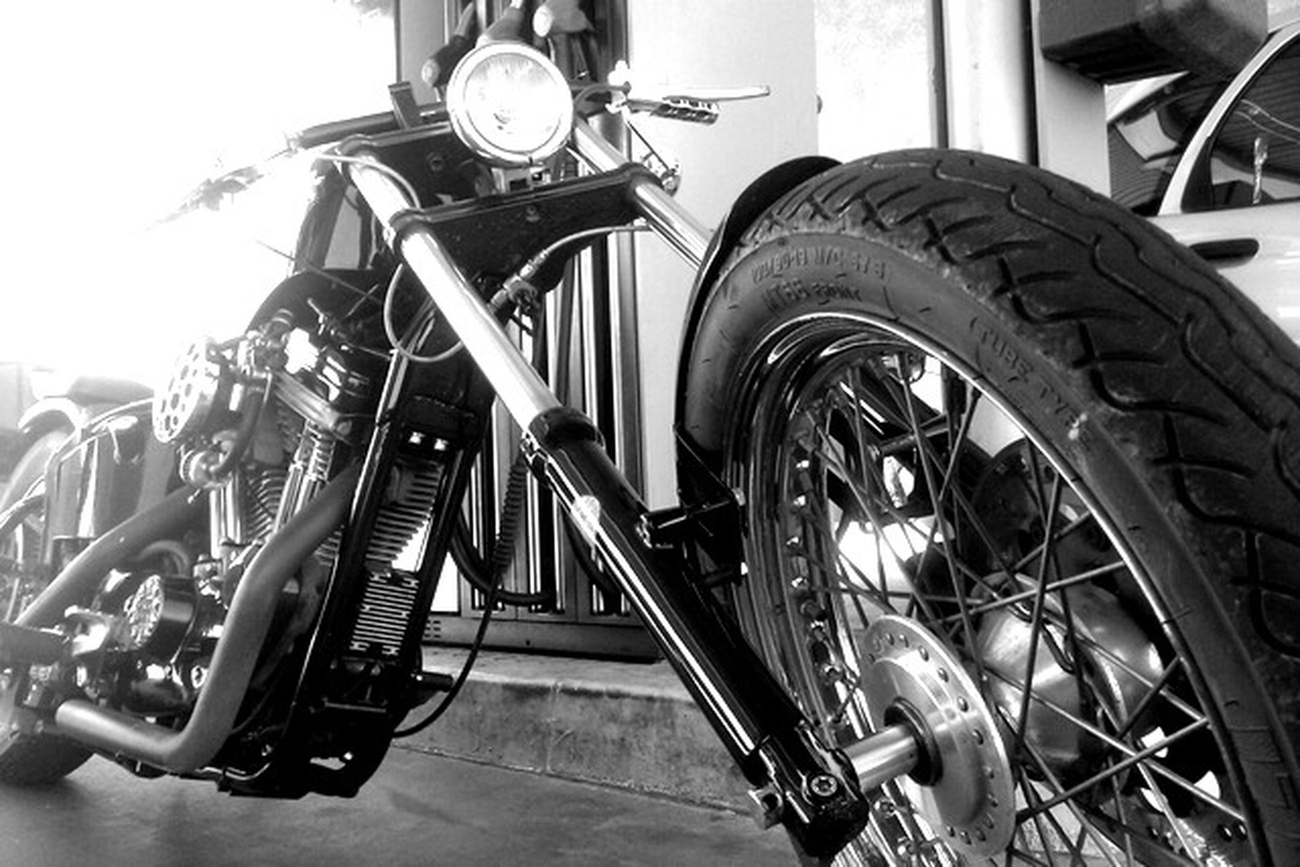 transportation, mode of transport, land vehicle, bicycle, stationary, wheel, metal, built structure, old-fashioned, architecture, machinery, day, travel, parked, motorcycle, no people, low angle view, retro styled, machine part, parking