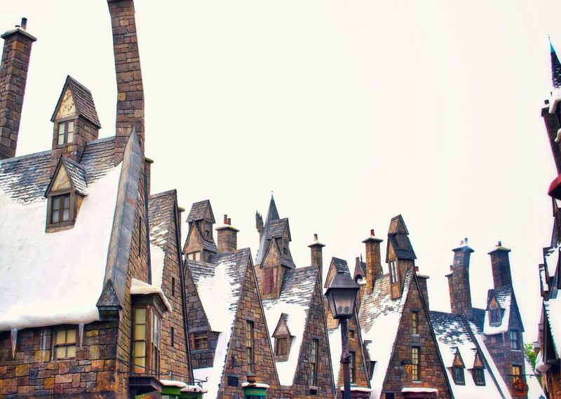 Architecture Building Exterior Travel Destinations Wizard World Tourist Attraction  Universal Studios Orlando Hogsmeade Harry Potter ⚡ Harry Potter Snow Orlando USAtrip Orlando Florida Universal Studios  Tourist USA Built Structure Roof Tops Rain