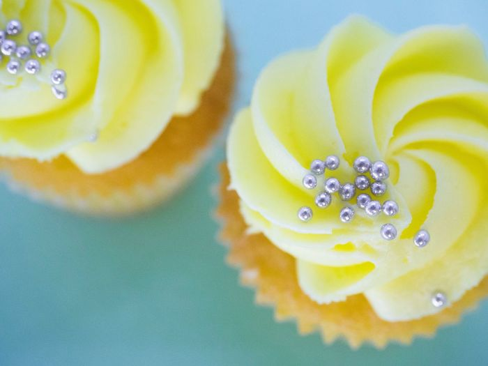 Lemon cupcakes view from above Pastel Pastel Colored Temptation Sweet Dessert Food Sweet Food Cupcakes Yellow Backgrounds Close-up No People Fragility Indoors  Freshness