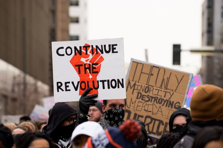 Denver, Colorado - January 20, 2017. Hundreds of people march through downtown Denver in protest of Trumps inauguration. Photojournalism Protesting Political March Politics Defiance Rally Protest Signs Protest Protestor Social Issues Placard Men Politics Banner - Sign Large Group Of People Crowd Unity Real People Anger Message Holding City
