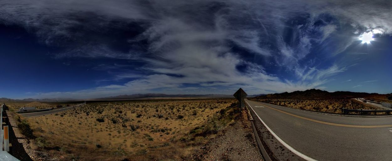 Panoramic shot of road on land against sky