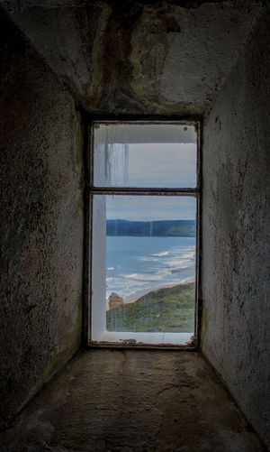 Sea Ocean View Ocean Lighthouse Space Water Frame Window Abandoned Looking Through Window Sky Architecture Built Structure