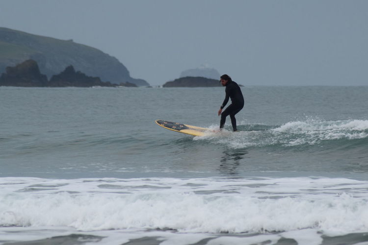 Adventure Day Lifestyles Longboard Morning Surf Nature One Person Outdoors Sea Sport Surf Surfing