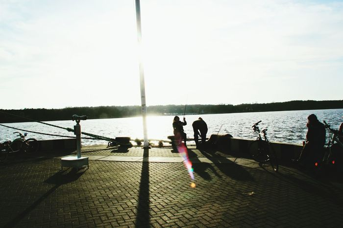 Sunlight Water Shadow Sun Sunny Sky Relaxation Cloud Solitude Day Group Of People Person Sunbeam Pathway Calm Lens Flare Walkway Ocean Tranquil Scene Tranquility Fishing Fisherman Fishermanslife Fisher Man People And Places