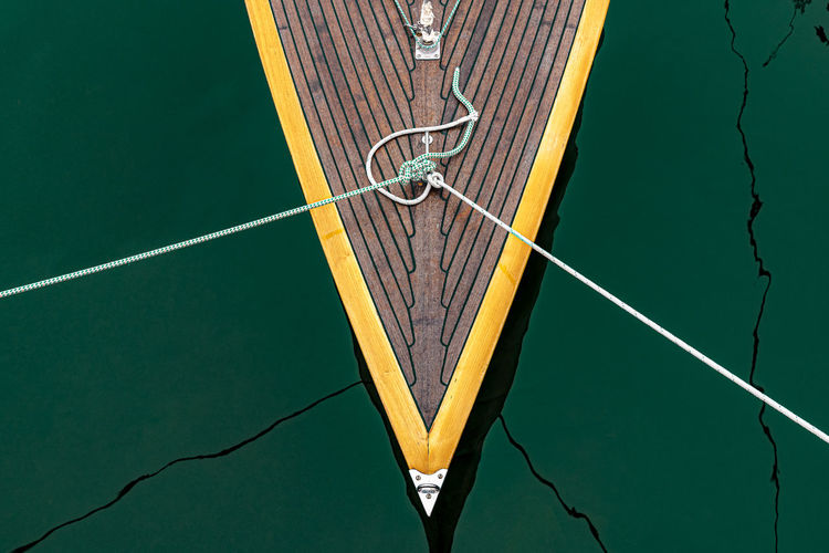 High angle view of ropes tied to boat on lake