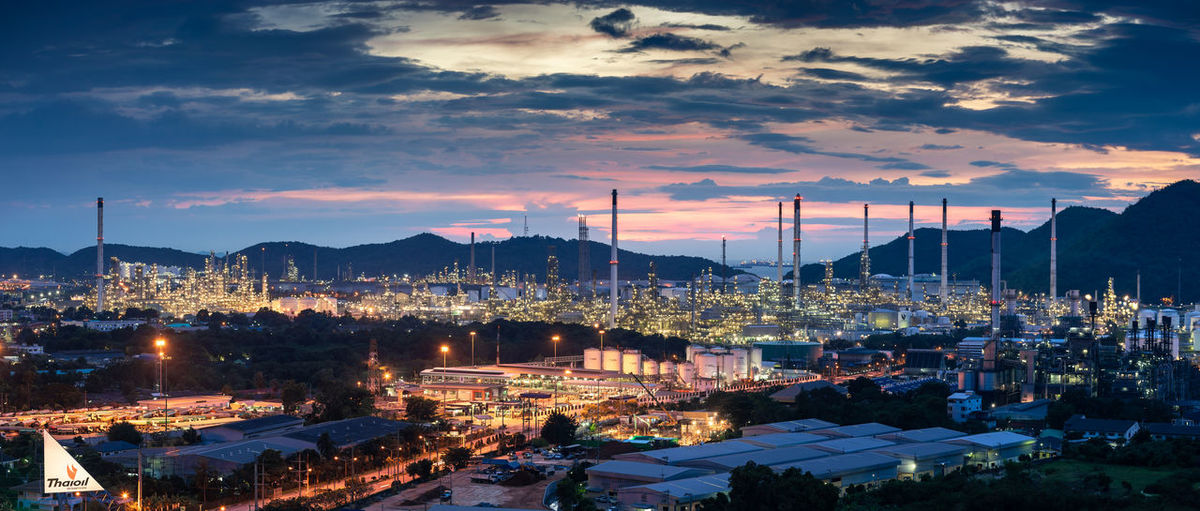 Beautiful sunset petrochemical oil refinery factory plant , cityscape of chonburi thailand at night