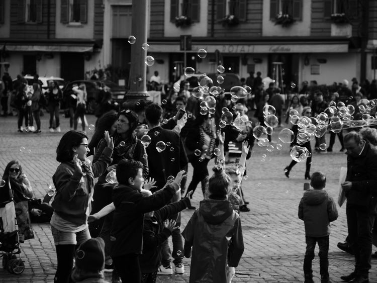 Black & White Lather Kids Playing Bubbles Bubbles In The Sky Rome